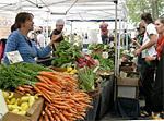 Carrots and other vegetables for sale at Ballard Sunday Farmers' Market, Ballard Avenue (historic district), Ballard, Seattle, Washington. Photo by Joe Mabel